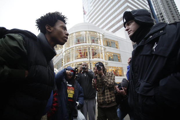 Lamon Reccord (l.) has become a face of Chicago protests.