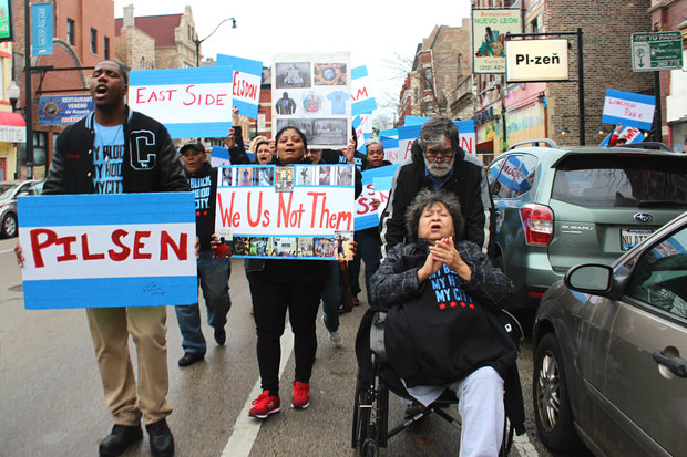 Jahmal Cole, Ivy Bullock and Magda Ramirez Castenada lead a group of 100 during the My Block, My Hood, My City march on 18th Street in Pilsen Sunday.