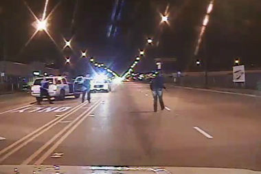 Officers Joseph Walsh (l.) and Jason Van Dyke approach Laquan McDonald seconds before Van Dyke shot the 17-year-old.