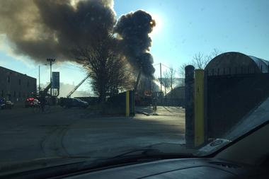 The scrapyard fire was declared Hazmat Level 1 by the Fire Department about 9:35 a.m.