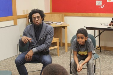 Ade Abioye is the teen program director. He moderates the discussions for the Barbershop at the Library program.