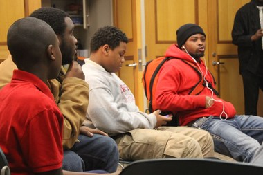 Englewood teens talk about gun violence and other issues at 'Barbershop at the Library,' a new program offered through the West Englewood Library.