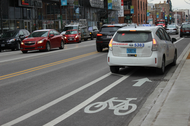 A cab parked in a bike lane in the 1440 block of North Halsted Street