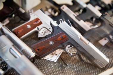 A variety of guns are seen in this file photo.