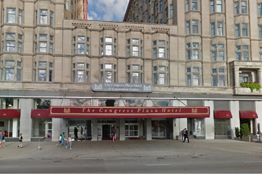 Five people were robbed at gunpoint in a hotel room at the Congress Plaza, police said.