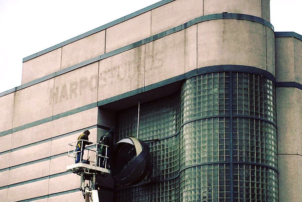 The iconic sign from the Harpo Studios building was removed Monday in the West Loop.