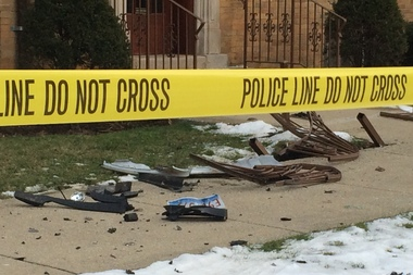 Car crash debris was seen near the shooting scene Wednesday afternoon.