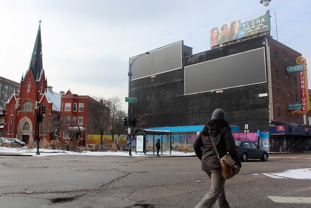 A fight over two large billboards overlooking the square in Logan Square will likely be settled in the coming months.