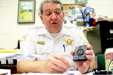 Chicago Police Commander Marc Buslik explains the charging and upload process for body cameras.