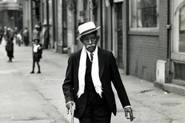 An unidentified black man is seen walking in Bronzeville on Easter morning in this undated photograph. Bronzeville was one of the few neighborhoods where millions of African-Americans who flooded Chicago during the Great Migration from the South could live.