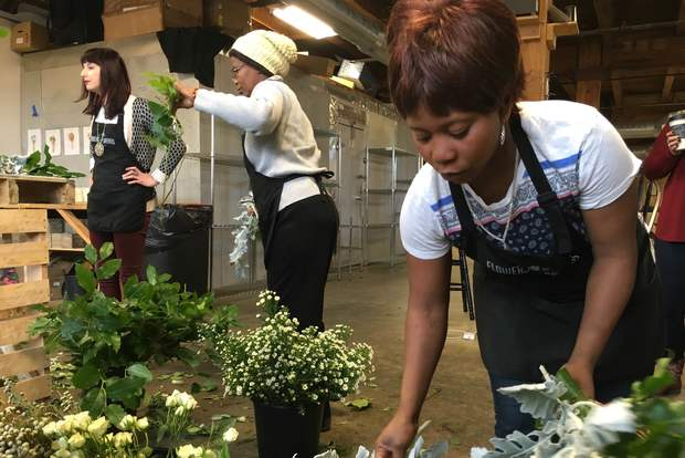 Sifuni Emidi, a refugee from the Democratic Republic of Congo, learns how to design floral bouquets at a workshop Saturday.