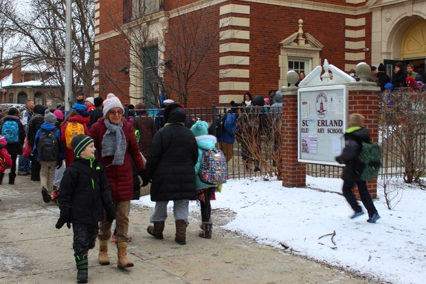 Students are released at the end of the day on Monday at Sutherland Elementary School in Beverly. Cleanliness has become an issue since icy sidewalks last Monday sparked a debate over janitorial service provider Aramark.