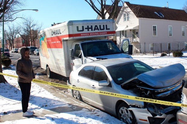 A shootout between a U-Haul and another vehicle in West Humboldt Park Thursday morning left a 16-year-old girl wounded on her walk to school, police and neighbors said.