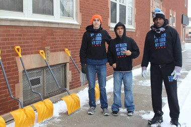 Casey Merchant (l.) Hector Delarosa (c.) and Jahmal Cole (r.) shovel snow for senior citizens for free in Chatham Monday.