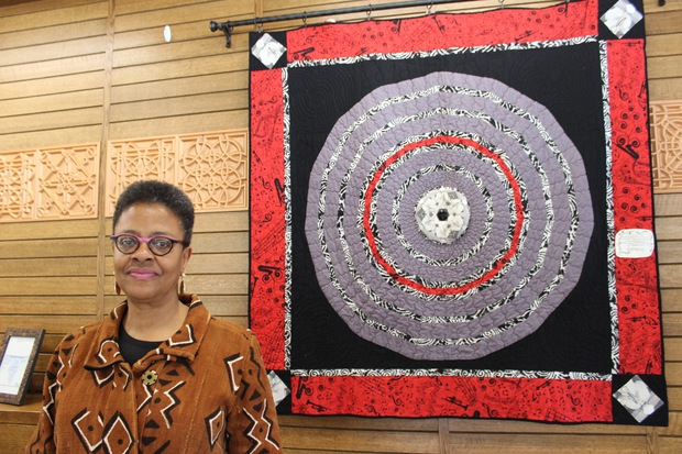 Nik-ki Whittingham of Hyde Park works at the Quilter's Trunk in Beverly. Whittingham's quilt is a tribute to jazz trumpeter Miles Davis. It features a photograph she took of Davis in 1983 and is on display for Black History Month.