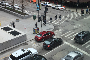 A motorist using a Dearborn bicycle lane as a turn lane last month near the Daley Center, 50 W. Washington St.