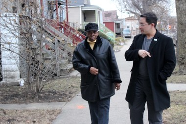 Englewood resident Gwendolyn Johnson talks to 15th Ward Ald.Raymond Lopez about the abandoned buildings on her block.