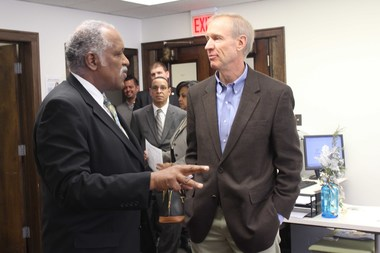 Gov. Bruce Rauner (r.) talks to Englewood Blue Chief Technology Officer Bruce Montgomery Monday at Englewood Blue.