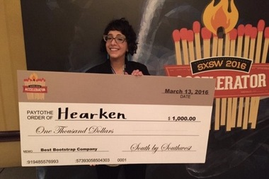 Hearken co-founder Jennifer Brandel receives a check for $1,000 at SXSW after Hearken was named the Best Bootstrap Company.