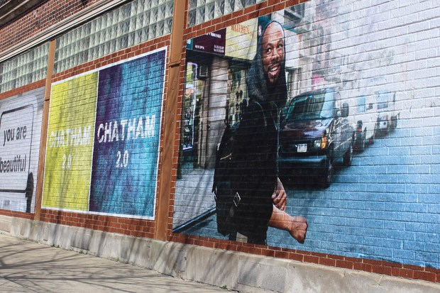 Local artist Chris Devins put up a painting of hip-hop artist Common on 79th St. as part of the