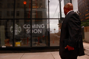 A man passes by a new Starbucks opening in Mila, 200 N. Michigan Ave.