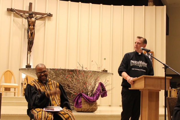 The Rev. Dennis Langdon (l.) of Morgan Park United Methodist Church introduced the Rev. Michael Pfleger during a prayer service Feb. 27 at St. Barnabas Parish in Beverly. The event was part of the