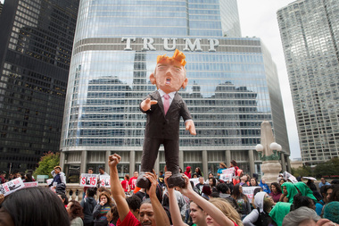 Demonstrators hold up a piñata of Republican Presidential candidate Donald Trump during a protest outside Trump Tower on October 12, 2015 in Chicago. About 250 demonstrators marched through downtown before holding a rally calling for immigration reform and fair wages in front of Trump Tower. Trump has been an outspoken proponent of a plan to deport undocumented immigrants.
