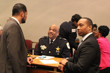 Interim Police Supt. Eddie Johnson talks with Aldermen Anthony Beale (l.) and Greg Mitchell (r.) before Tuesday's committee meeting.