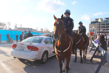 Mounted police units helped direct traffic along Clark and Addison streets for the 2016 home opener.