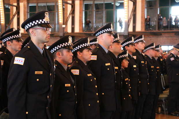 Officers stand at a Chicago Police Department promotion ceremony.
