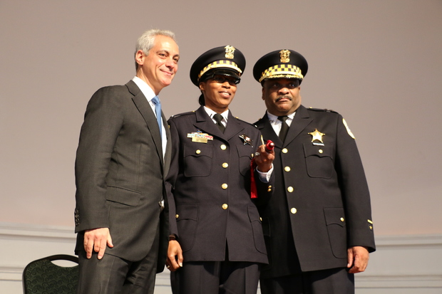 Lt. Maryet Hall (c.) poses with Mayor Rahm Emanuel (l.) and interim Police Supt. Eddie Johnson at a Chicago Police Department promotion ceremony.