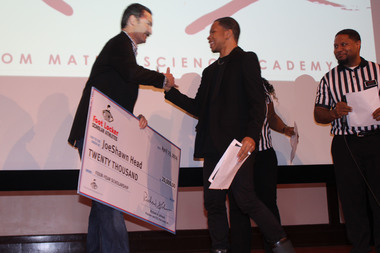 Lindblom Math and Science student JoeShawn Head was awarded the Gates Millennium Scholarship. He is seen here receiving a Foot Locker Scholar Athletes award.