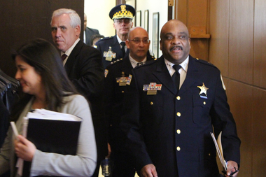 Backed by the man he replaced as interim police superintendent, John Escalante, Eddie Johnson arrives for his City Council hearing.