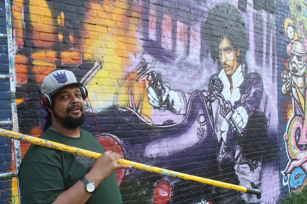 "Rahmaan ""Statik"" Barnes started on Sunday painting a mural of Prince as he appeared on the"