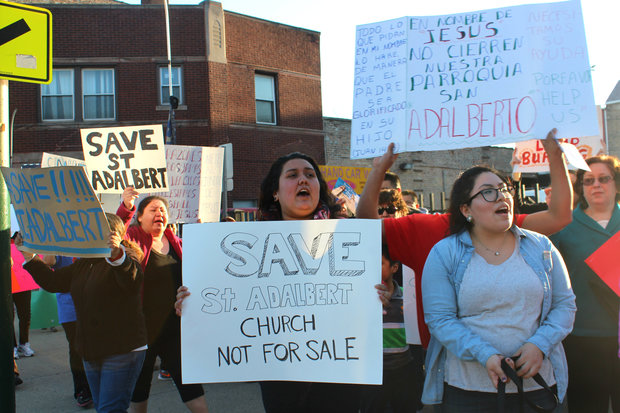 About 100 parishioners protested the planned closing of St. Adalbert's Catholic Church in Pilsen Friday.