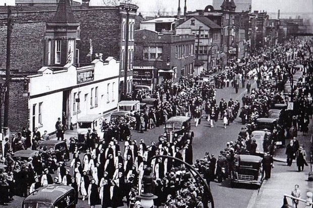 A parade or procession near the former Ukrainian Dairy, believed to have taken place in the 1940s, according to local historian Elaine Coorens.