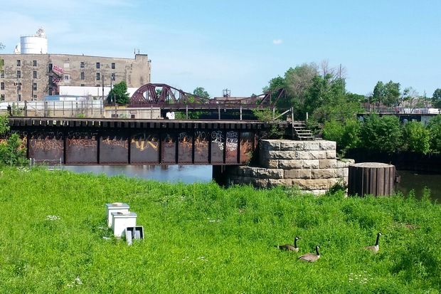 A defunct wooden swing bridge that dates to the late 1890s, just south of the Cortland Street Bridge.