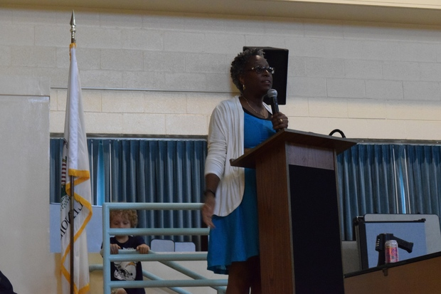 Gale Elementary's former principal Cassandra Washington speaking to community members in May.