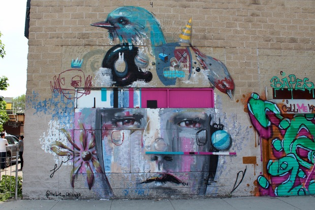 About 25 artists came together to paint the entire exterior of  Mega Mall in Logan Square before the building is demolished.