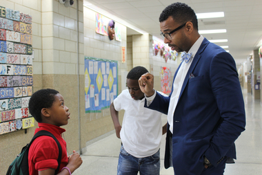 Principal Robert Croston talking to a student at Jenner Elementary.