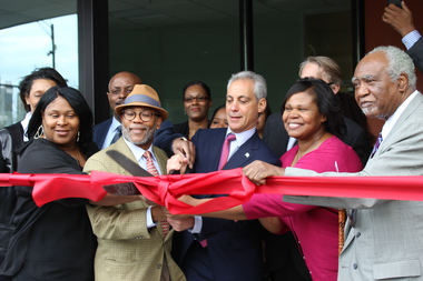 Deidre Brewster, Cabrini-Green activist, Ald. Walter Burnett Jr. (27th), Mayor Rahm Emanuel, current tenant Armesha Jones and Congressman Danny Davis cut the ribbon at the Parkside of Old Town, 459 W. Division St.