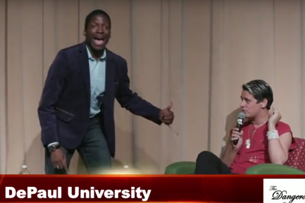 A Black Lives Matter protester takes over the stage as Breitbart's Milo Yiannopoulos spoke with a crowd at DePaul University.