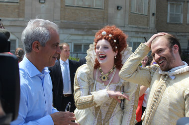 Mayor Rahm Emanuel talks with actors dressed as Elizabeth I and William Shakespeare at an event announcing the return of Shakespeare In the Parks.
