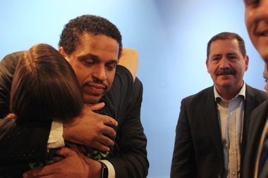 Ousted Blaine Principal Troy LaRaviere (l.) hugs a supporter as County County Board Commissioner Jesus