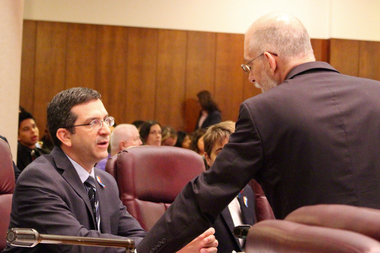 Ald. Scott Waguespack questions city lawyer Jeffrey Levine on a procedural matter during Wednesday's debate on ride hailing.
