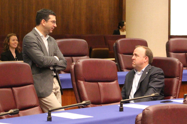 Aldermen Scott Waguespack and Brendan Reilly discuss the home-sharing ordinance before a Wednesday committee meeting.