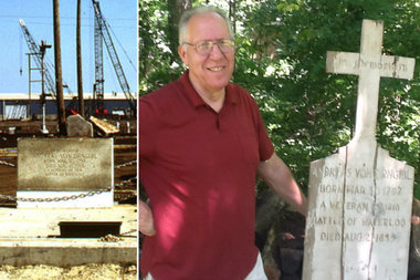 Mark Paul Zirngibl with a wooden grave marker for his great-great-grandfather Andreas von Zirngibl, who fought Napoleon in the Battle of Waterloo. The current gravesite is inside a closed metal recycling plant at 9331 S. Ewing Ave.