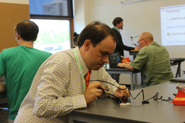 A teacher working with materials during a fabrication workshop at Catherine Cook School's second annual conference.