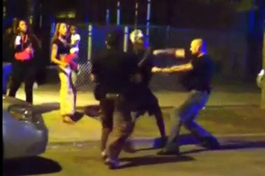 A Chicago Police officer can be seen punching a man while breaking up a block party in 2014.