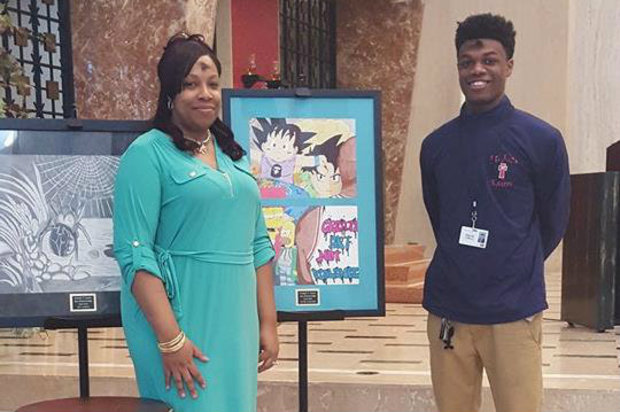 David Gilliard and his mom, Tanika Coleman, show off Gilliard's scholarship-winning artwork at St. Rita High School.